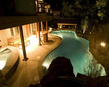 Natural Stone and Coping around the pool at Night.