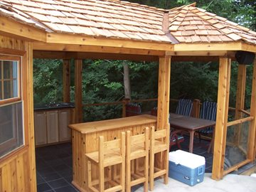 Cabana with outdoor kitchen and eating area
