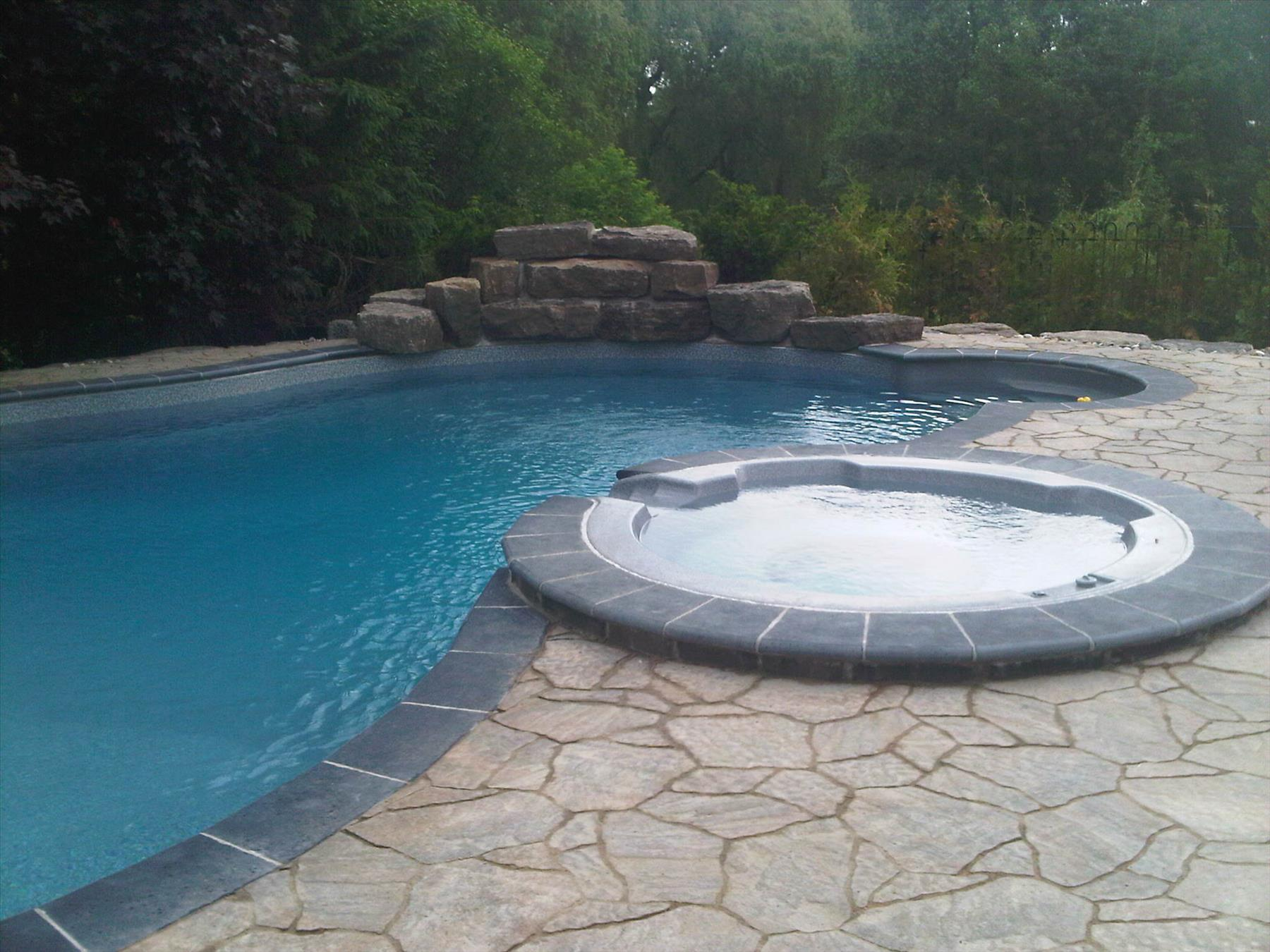 Precast stone around pool and hot tub